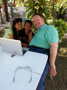 Showing Babeselle and Mimi the new Chromebook for the children's home.
