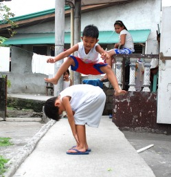 Luksong-Baka or jump over the cow.  All Philippine games site