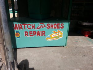 Watch and shoe repair booth