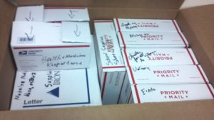 boxes packed and labeled for the recipients.