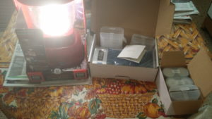 New Lantern in the daylight with batteries and charger.